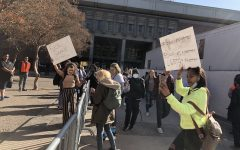 Protestors gather around the fence by the Young Republicans booth outside of Glenn Hall. Photo credit: Ricardo Tovar