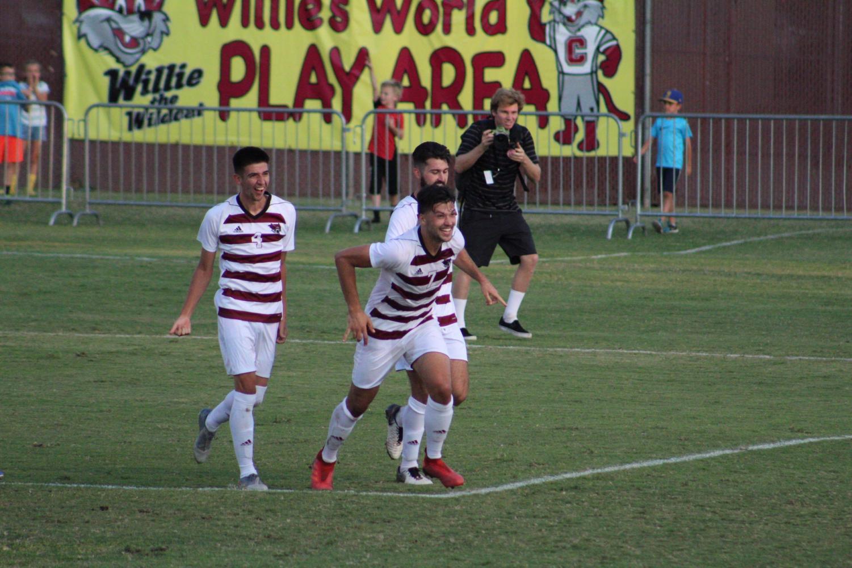 Ronan McEnroe (middle) celebrating a goal at University Soccer Stadium. Photo credit: Wesley Harris