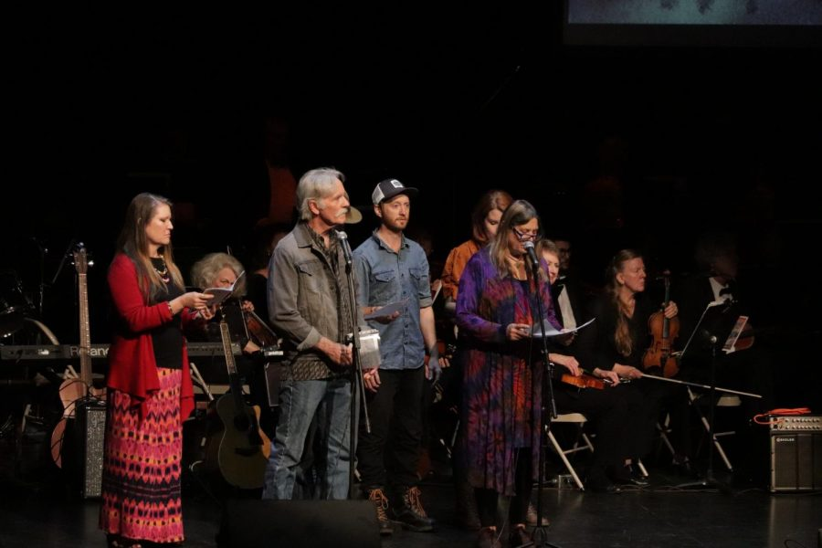 A creative ensemble singing and speaking about how people felt about the devastating fire. Photo credit: Hana Beaty