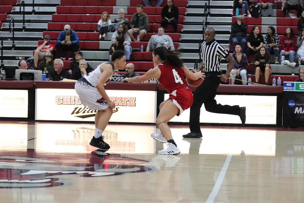 Chico player, Shay Stark and Holy Names player, Elle Burland, face off each other during the last ten minutes of the game. Photo credit: Melissa Herrera