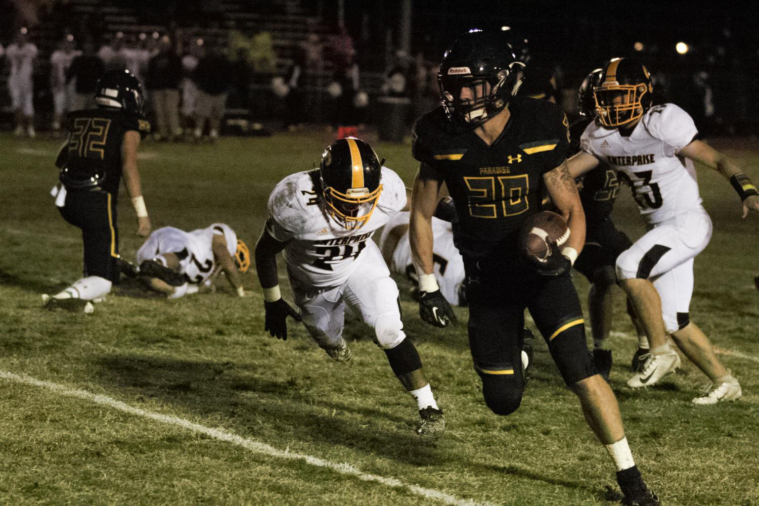 Lukas Hartley running for eventual touchdown. Photo credit: Wesley Harris