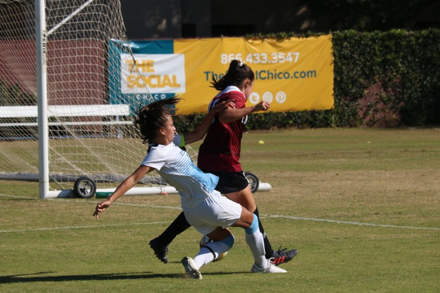 Sonoma player, Sam Layman, goes down and tries to take Chico player, Alexi Vontsolos, with her as well. Photo credit: Mary Vogel