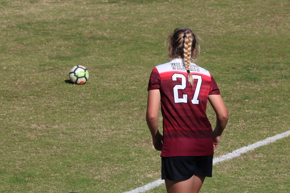 Freshman Liz Geraghty positioning her free kick against Sonoma State. Photo credit: Mary Vogel