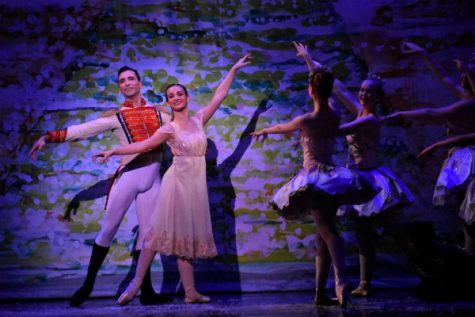 Angeline Stansbury (Adelaide Sands) and the Nutcracker Prince (Christopher B. Nachtrab) join the Almond Blossoms in dance. Photo credit: Rayanne Painter