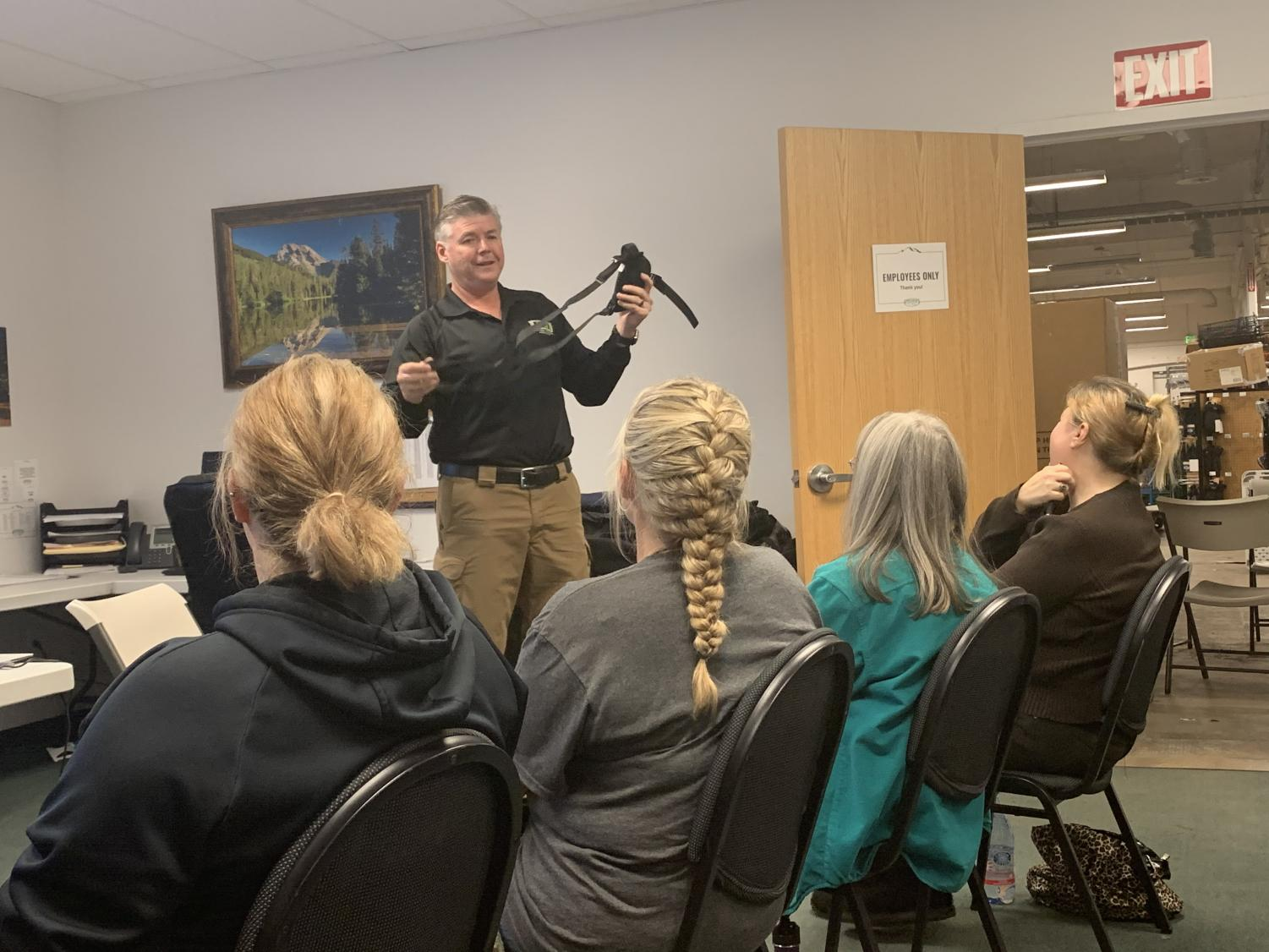 Ted Lidie showing his students what a shoulder halter looks like. Photo credit: Angelina Mendez