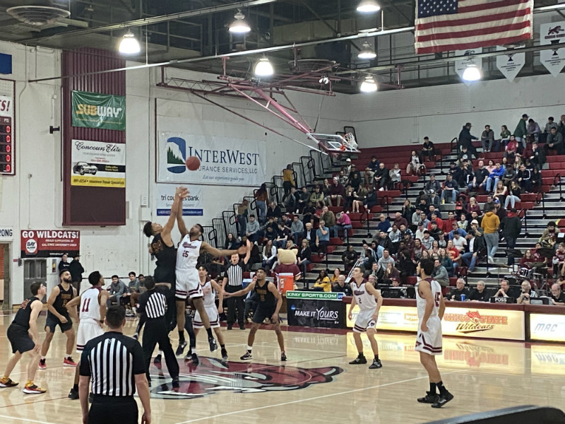 The tip-off begins the game between Chico State and Cal State Dominguez Hills.