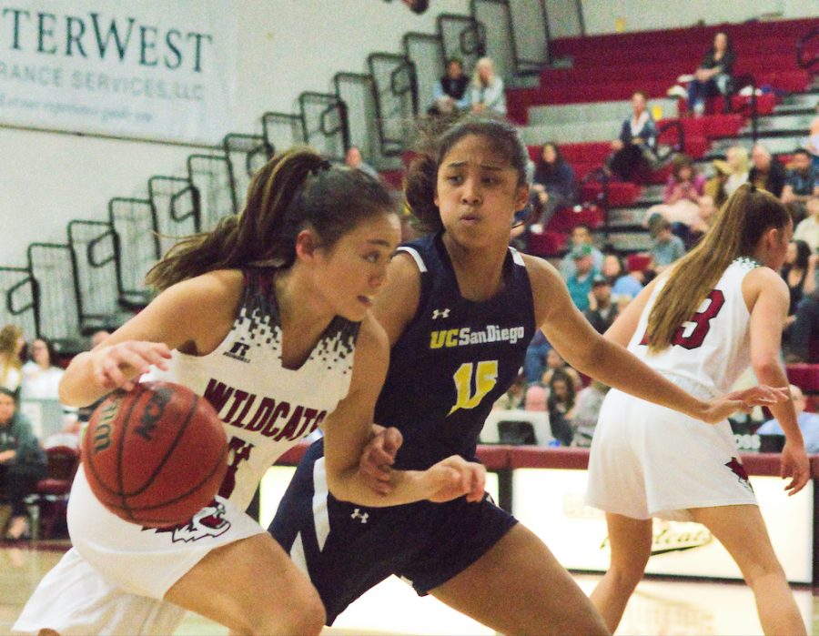 Maddy Wong dribbles the ball in effort to get away from her opposing guard.