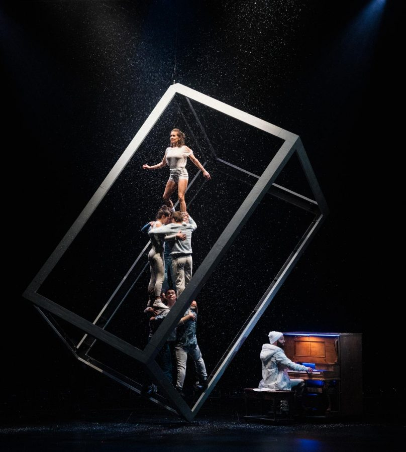 The large cube served not only as a prop, but was used by the acrobats as a balancing beam throughout the performance.
