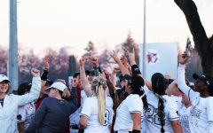 Chico State softball team chants in victory.