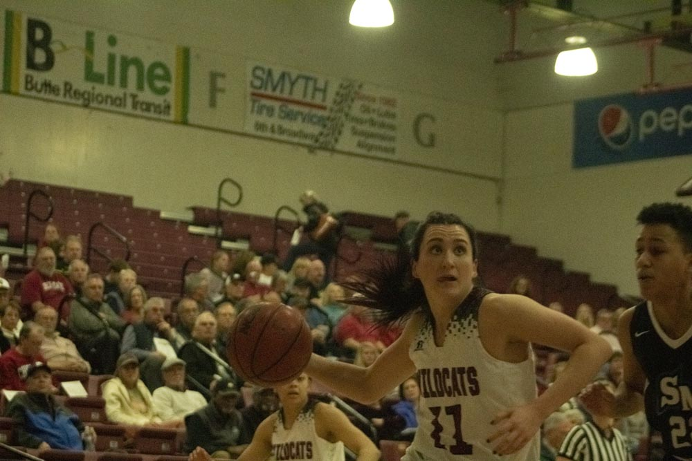 Brynn Thoming makes a move to the rim from the low post.