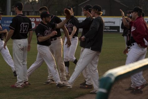 Daniel Foret praised by teammates after ending the inning.