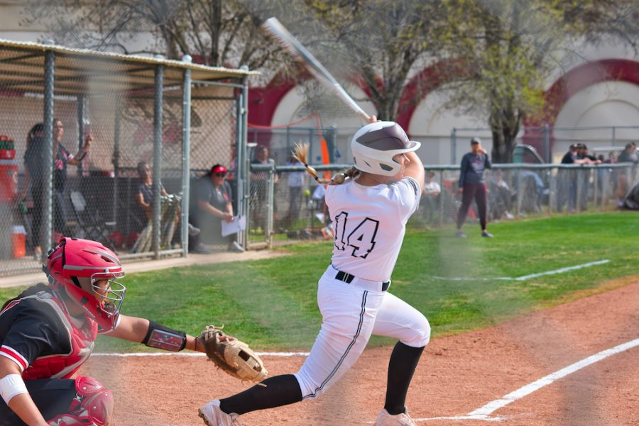 Brooke Larsen follows through a hard swing against Cal State East Bay.