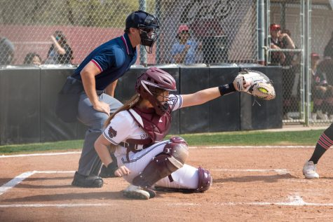 #15 Sara Mitrano catches a pitch in a game at Chico State