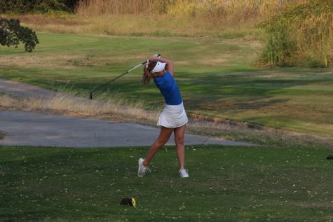 Lauren Millard takes a swing on a golf course for Rocklin High School where she played four years on the varsity team.