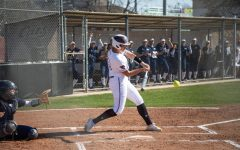 Reilani Peleti takes a swing in a softball game for Chico State.