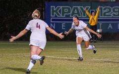 Erin Woods (left) and Susanna Garcia (right) celebrate after scoring a goal