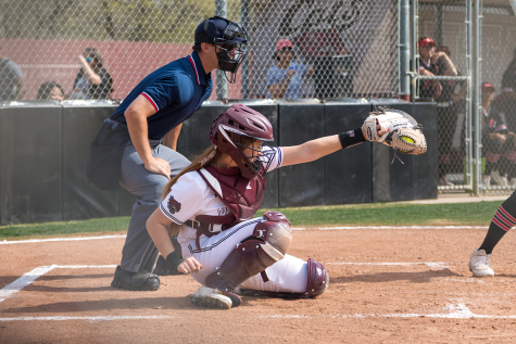 #15 Sara Mitrano catches a pitch in a softball game at Chico State (Ryan McCasland/Chico State Sports Information)