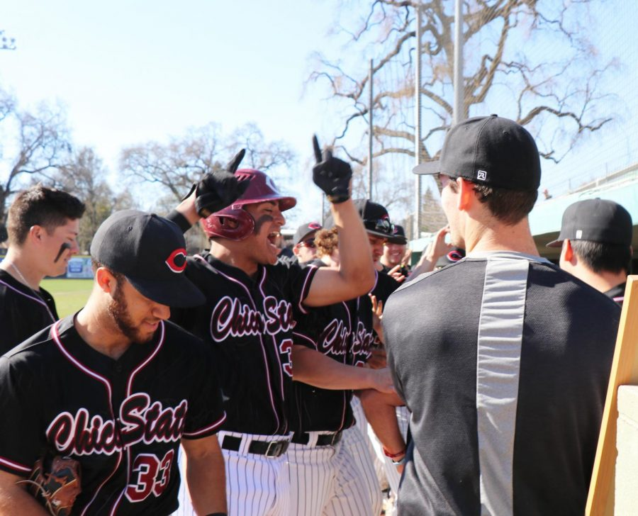 The Chico State baseball team celebrating a run being scored in the 2020 season. Photo credit: Dayanna Negrete