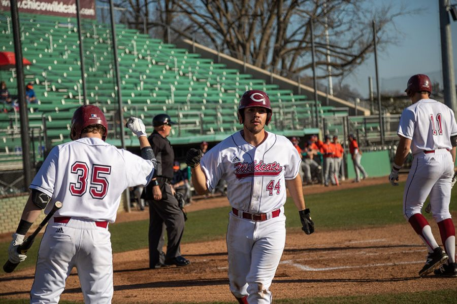 Jorge+Perez+%2844%29+scores+against+Fresno+Pacific+University+and+fist+bumps+Turner+Olson+%2835%29.+Photo+Courtesy+of+Chico+State+Sports+Information.