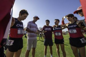 Coach Gary Towne (second from left) talks to the Chico State Wildcats before they compete in the men's 2019 NCAA Division II Cross Country Championships at Haggin Oaks Golf Course on Saturday, November 23, 2019 in Sacramento, Calif.