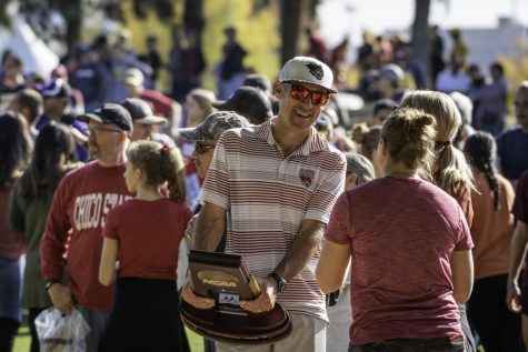 Coach Gary Towne (center) talks to fans after the Chico State Wildcats compete in the men's 2019 NCAA Division II Cross Country Championships at Haggin Oaks Golf Course on Saturday, November 23, 2019 in Sacramento, Calif.
