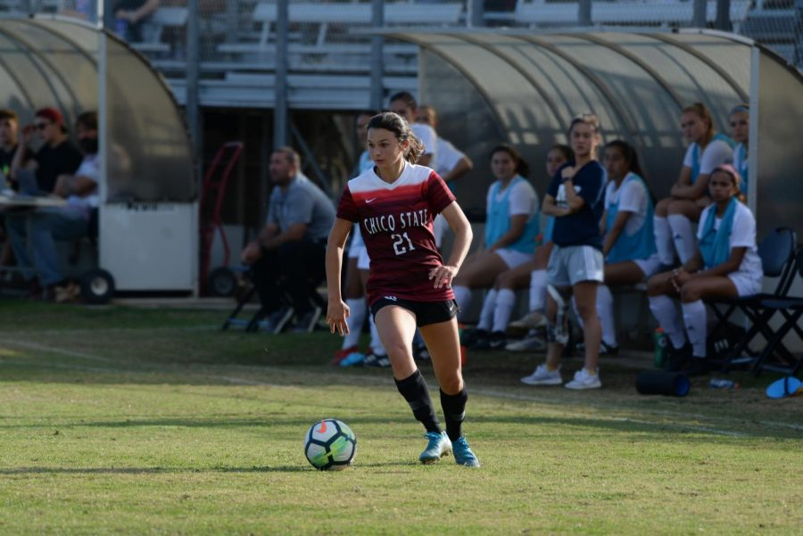 Camille Lidster, #21 of the Chico women's soccer team dribbles the ball for the team.