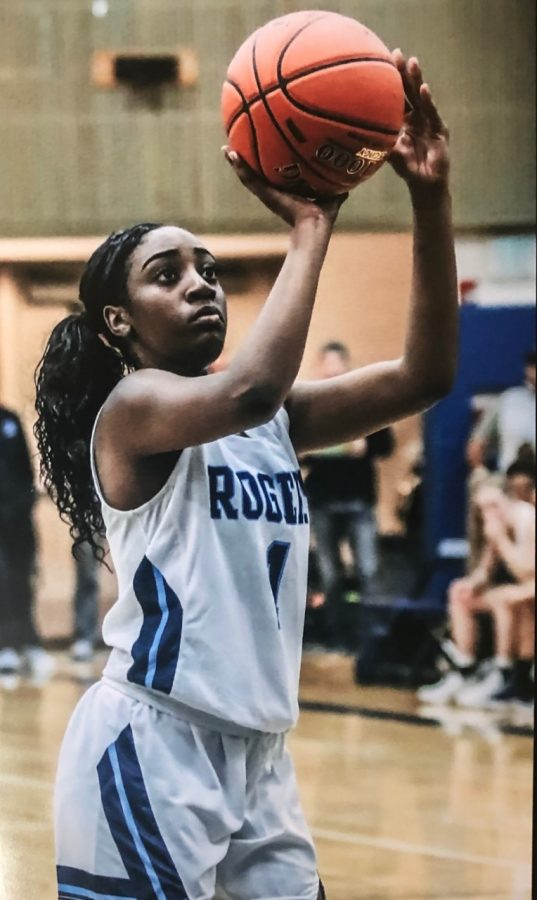 Jazmyne Lillie shooting a shot at Rogers High School in Puyallup, Washington.