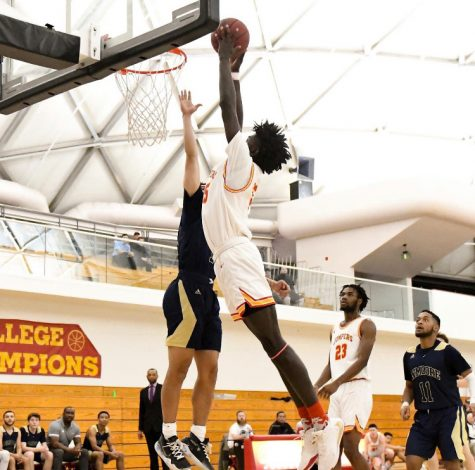 Kaleb Carter attempting to throw down a dunk at Columbia College.