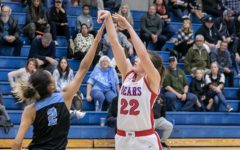 #22 Morgan Mathis throws up a shot in a basketball game at Buchanan High School in Clovis, Calif (Chico State Sports Information)