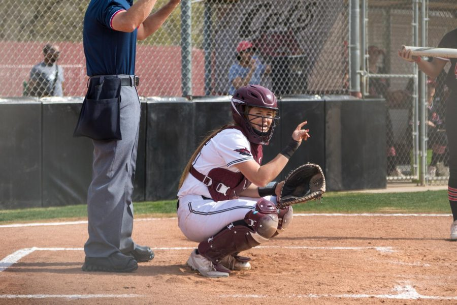 #15 Sara Mitrano throws up signs while catching in a softball game at Chico State (Ryan McCasland/Chico State Sports Information)
