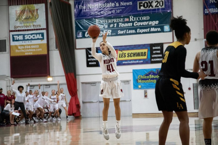 Courtesy of Chico State Athletics Chico womens basketball guard Jasmine Hess takes a shot during a game.