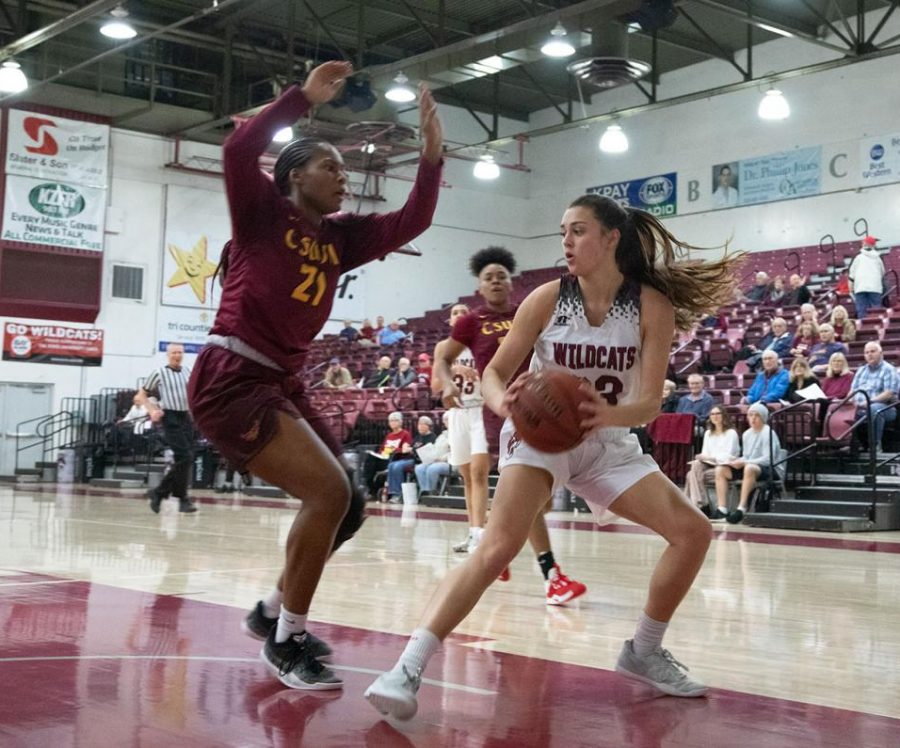 Haley Ison carries the ball in the paint during a game against CSUDH.