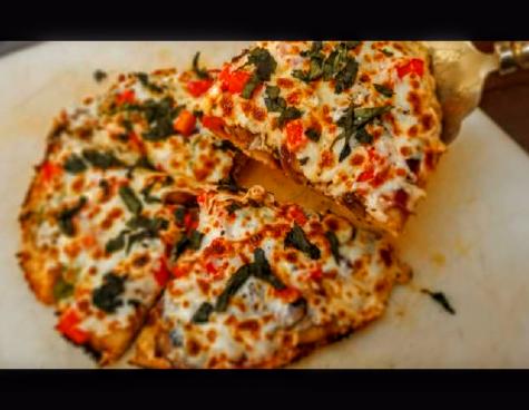 Shredded pork shoulder, mushroom, red onion and basil pan pizza.