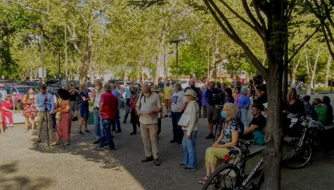 "Chicoans gather for Councilmembers Alex Brown and Scott Huber's press conference at the public art structure ""Our Hands"" in downtown Chico."