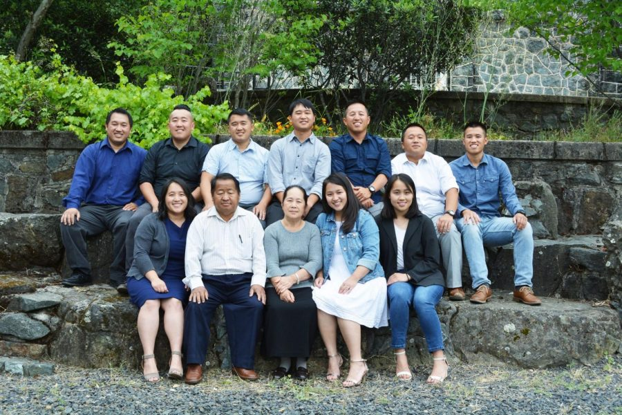 THE YANG FAMILY   (left to right): Kong, Sue, Ze, Dao, Teng, Cheng and Lang  (bottom, left to right): Zong, Dad, Mom, Chia and Pa.  Courtesy of Sheng Yang