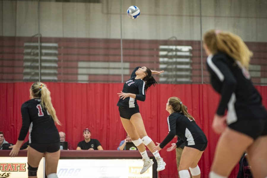 Chico State Wildcats' #11 Kelley Jacome (center) spikes against Cal State East Bay Pioneers during the first set of their women's volleyball game on Tuesday, October 1, 2019 in Chico, Calif. (Jason Halley/University Photographer/CSU Chico)