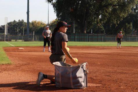 Kristin Worley coaches the softball team during practice. Photo taken on Aug. 23, 2021
