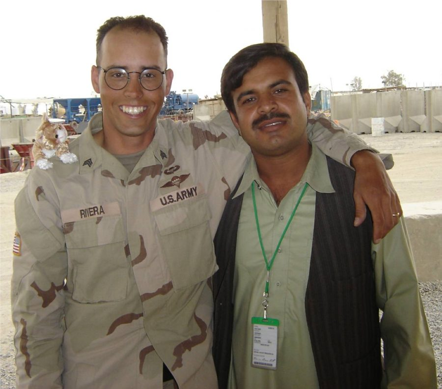 Oscar Rivera (left) pictured with interpreter Masud (right) during Riveras service in Afghanistan. Photo courtesy of Oscar Rivera, 2005.
