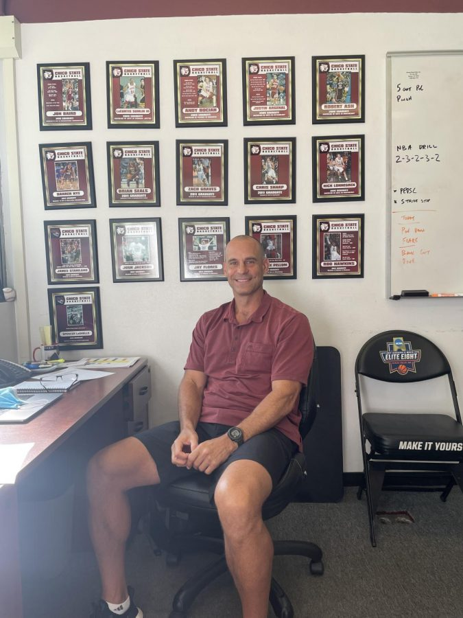 Chico+State+mens+basketball+head+coach+Greg+Clink+sits+in+his+office+in+front+of+pictures+of+former+Wildcats.