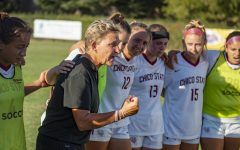 Jason Halley - University Photographer/CSU Chico Chico State Wildcats head coach Kim Sutton (center) encourages the team against Dominican Penguins during the second half of their women's soccer game on Thursday, September 12, 2019 in Chico, Calif.