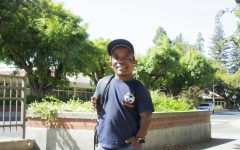 Michaud posing for a picture infront of Plumas Hall, Chico State.