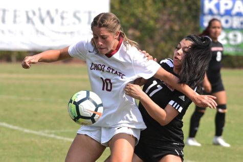 Freshman Kelli Litchfield holding off her defender in a match earlier this season.