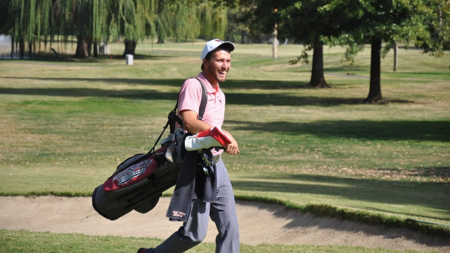 Chris Colla with a big smile after a hole.
