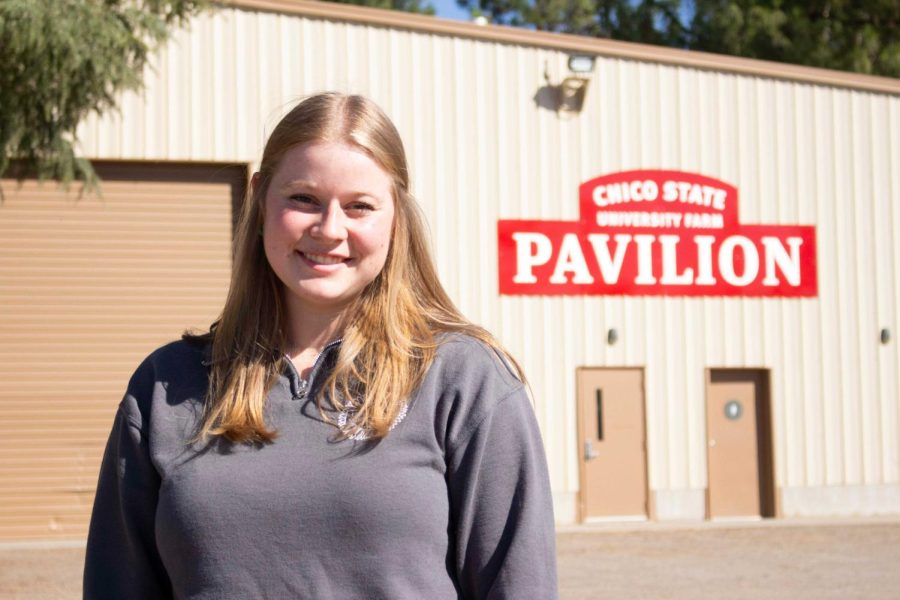 University Farm Tour Guide Amanda King waiting for tour goers in front of the Chico State University Farm Pavilion on Oct. 15, 2021.