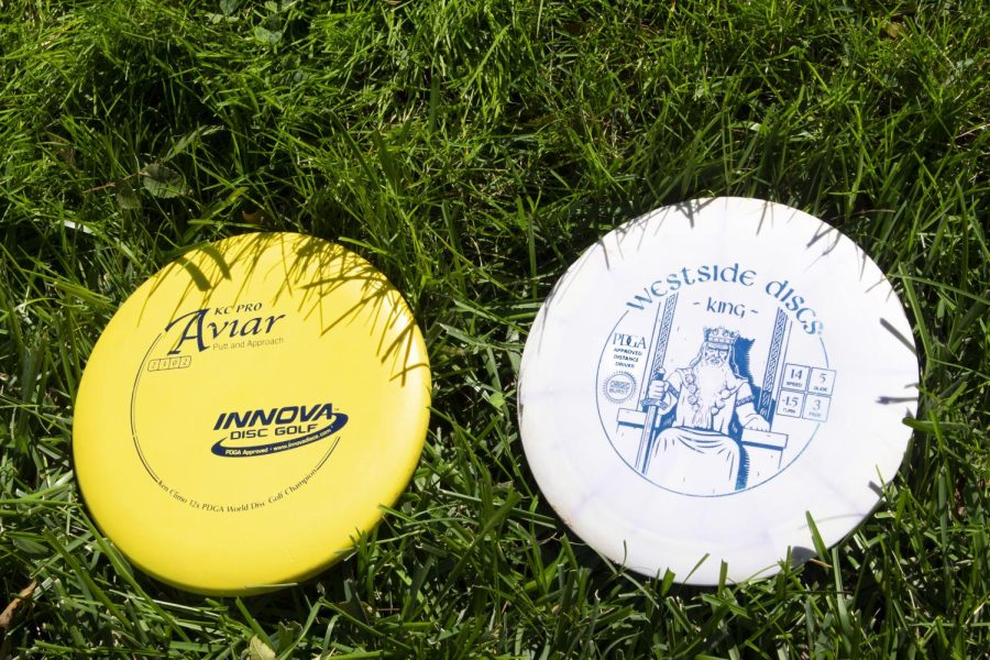 Professional Disc Golf Association approved putting disc (left) and distance driver (right).