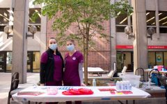 Nursing students, Ireland Vallejo (left side) and Katrina Tully (right side) giving out free swag to people who received flu shots on Oct. 14, 2021.
