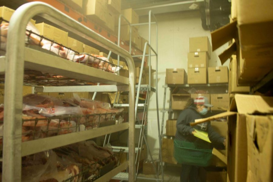 Meats Lab student Luz Morelos loading a customers ordered with processed meat from the Meats Lab freezer, taken on Oct 15, 2021.